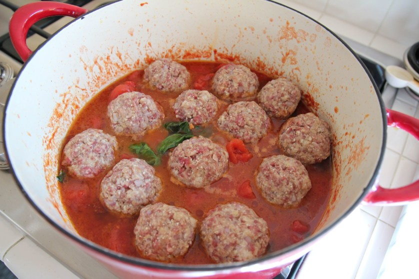 Meatballs cooking in the sauce